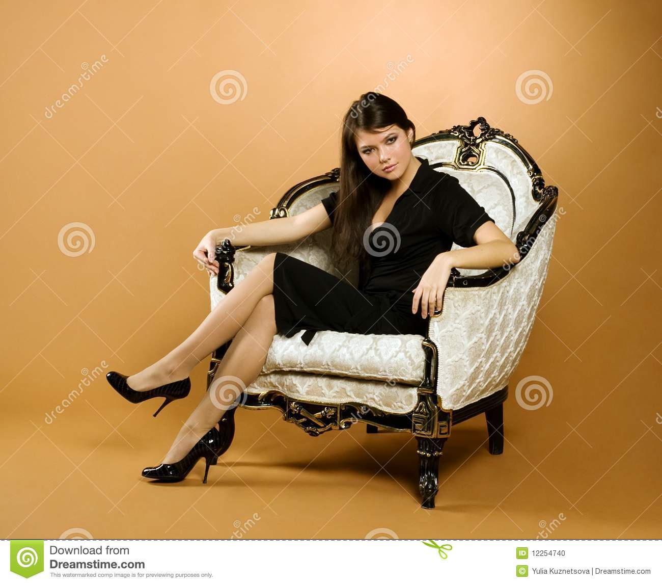 Young woman sitting in armchair stock photo image 12254740 for Sitting in armchair
