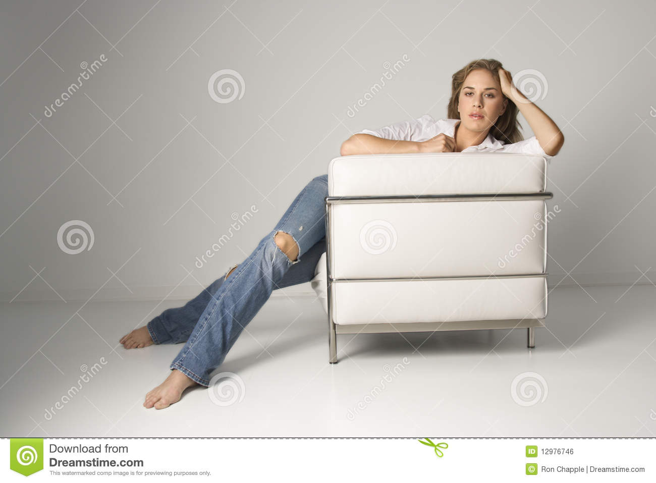 Young woman sitting in armchair royalty free stock image for Sitting in armchair