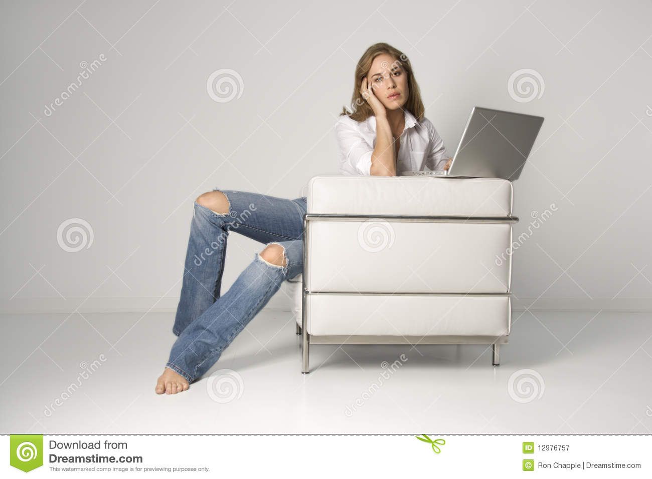 Young woman sitting in armchair with laptop stock image for Sitting in armchair
