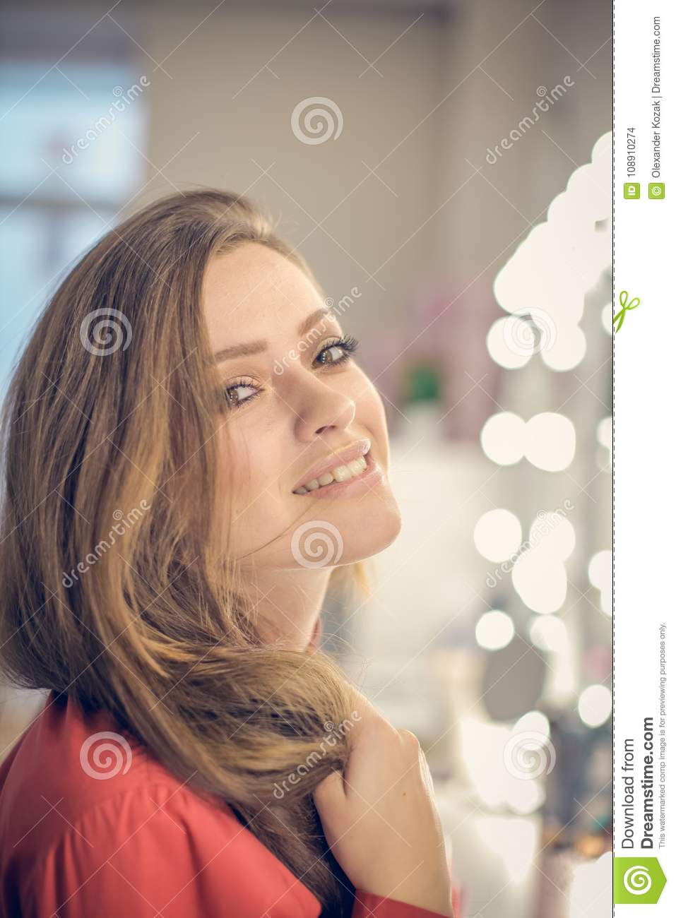Young Woman Sitting In Beauty Salon Is Posing On The Camera