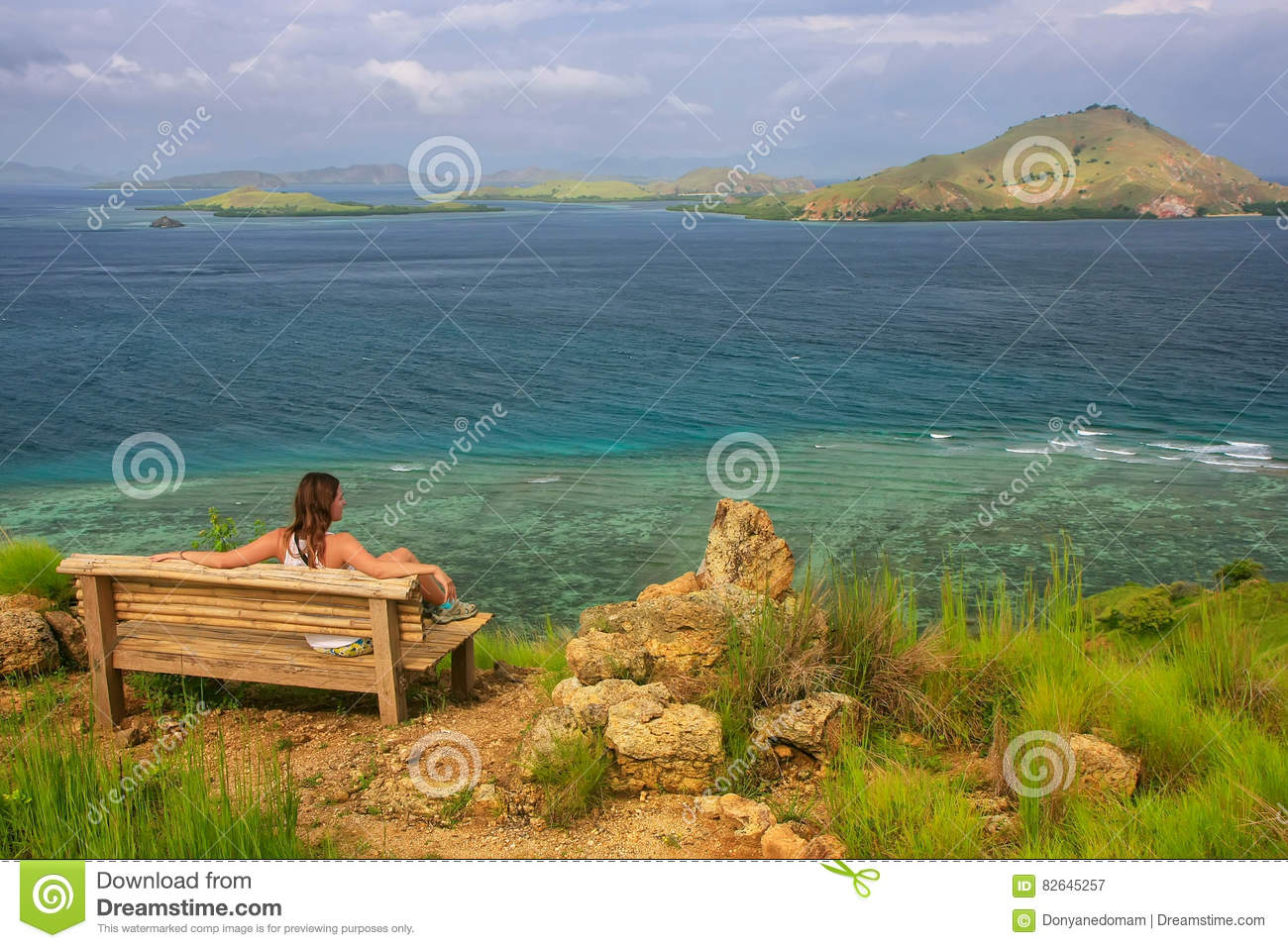Young Woman Sitting On A Bench At The Viewpoint On Kanawa