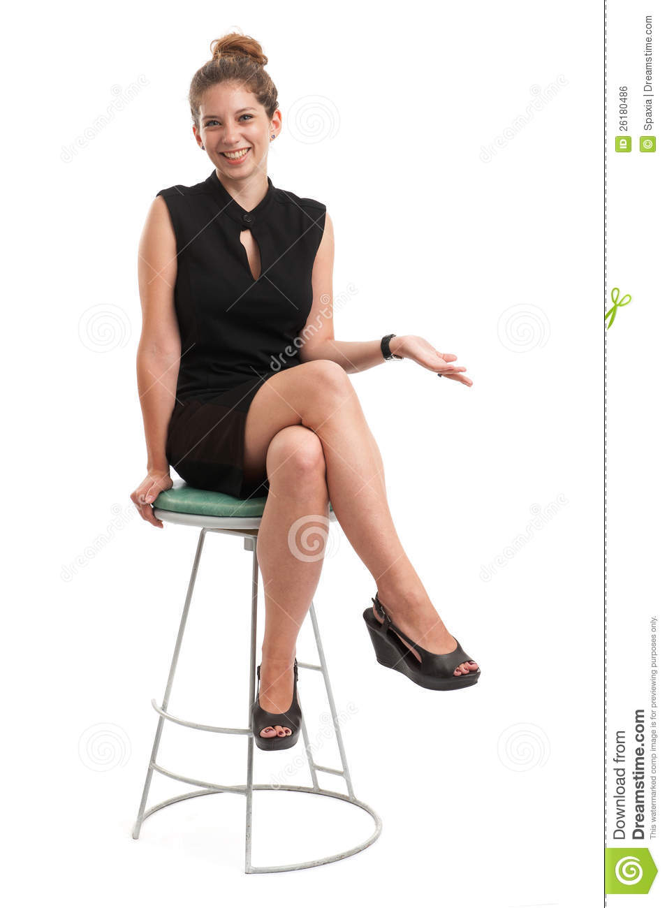 Young Woman Sitting On A Chair Royalty Free Stock Image