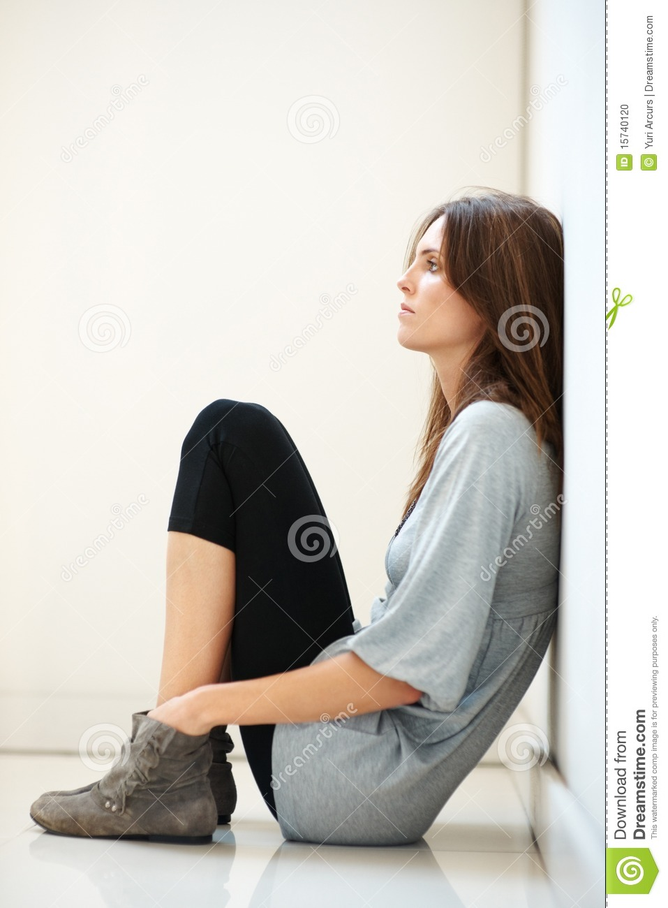 Stock photo young woman sitting on the floor and thinking for On the floor on the floor