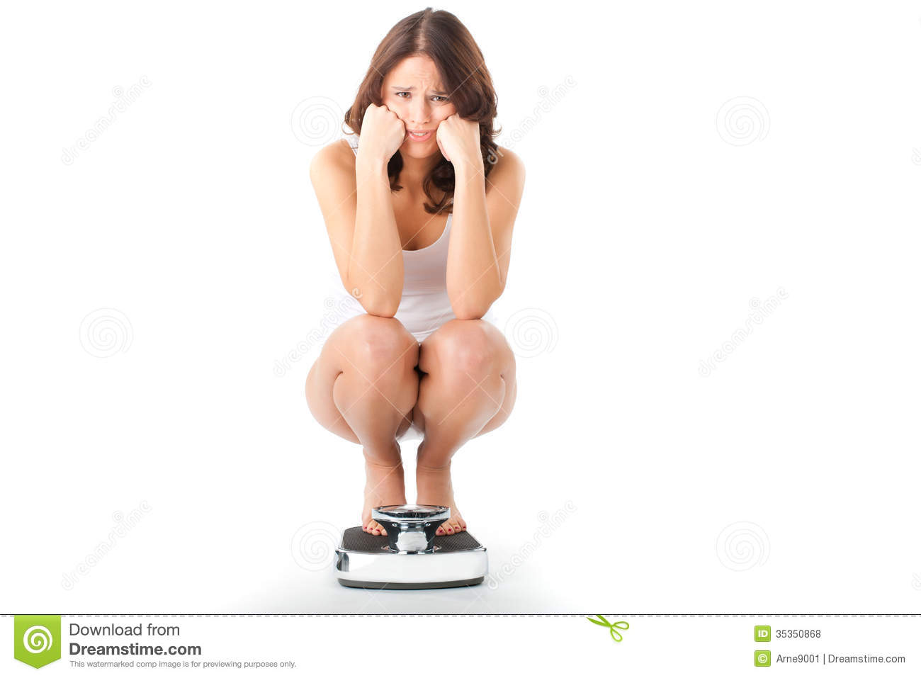 Royalty Free Stock Photos: Young woman sitting on her haunches on a ...