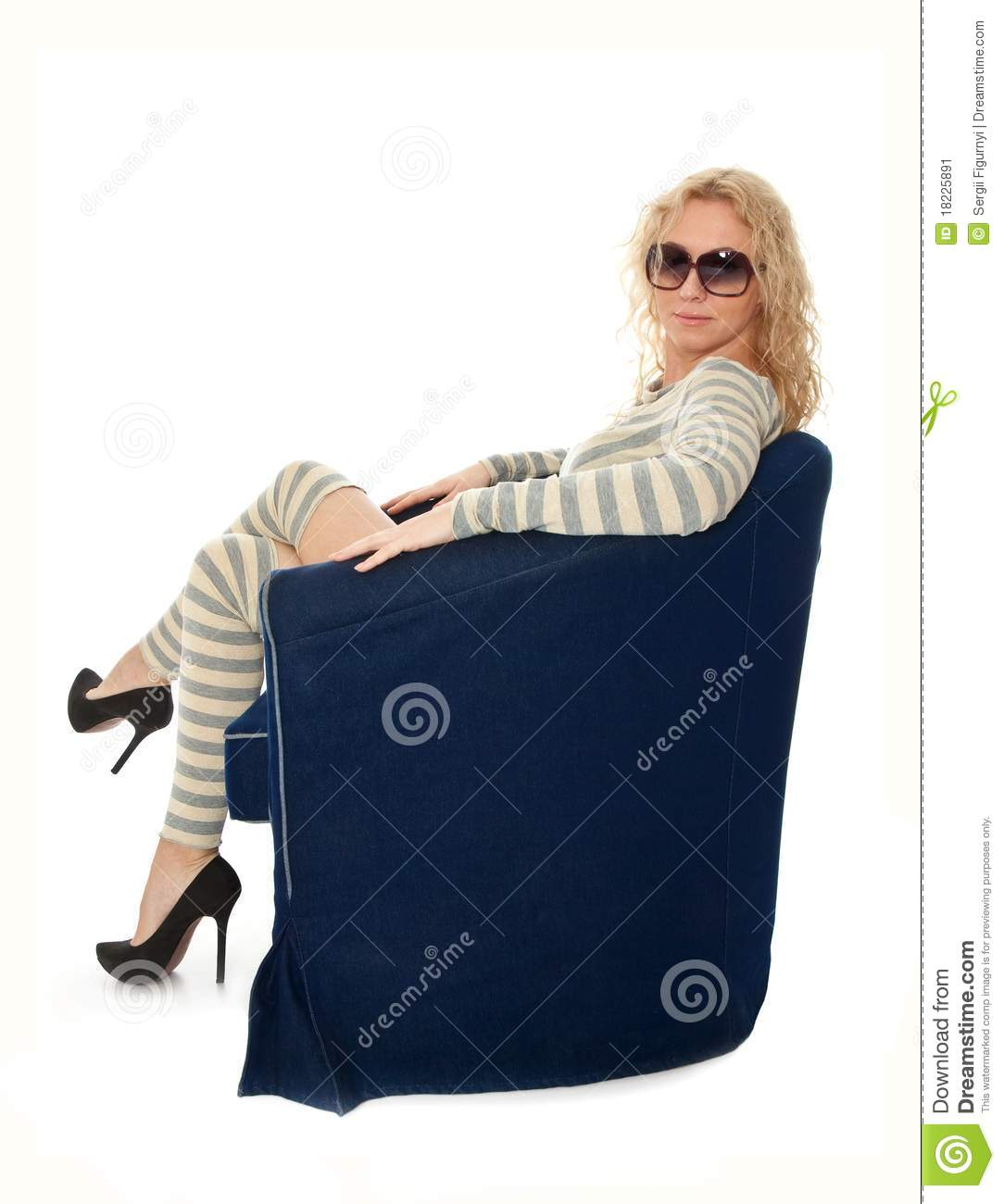 Young woman sitting in a navy armchair stock image image for Sitting in armchair