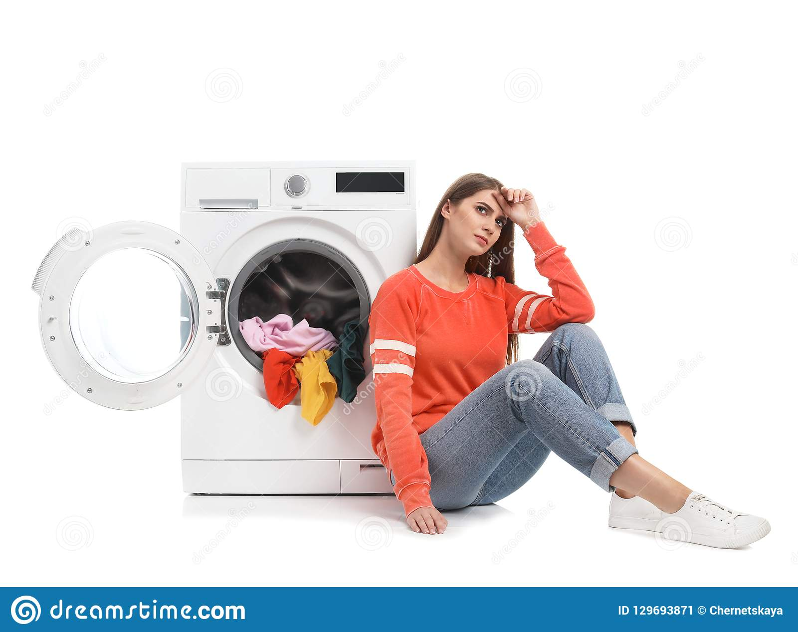 Young Woman Sitting Near Washing Machine With Dirty ...