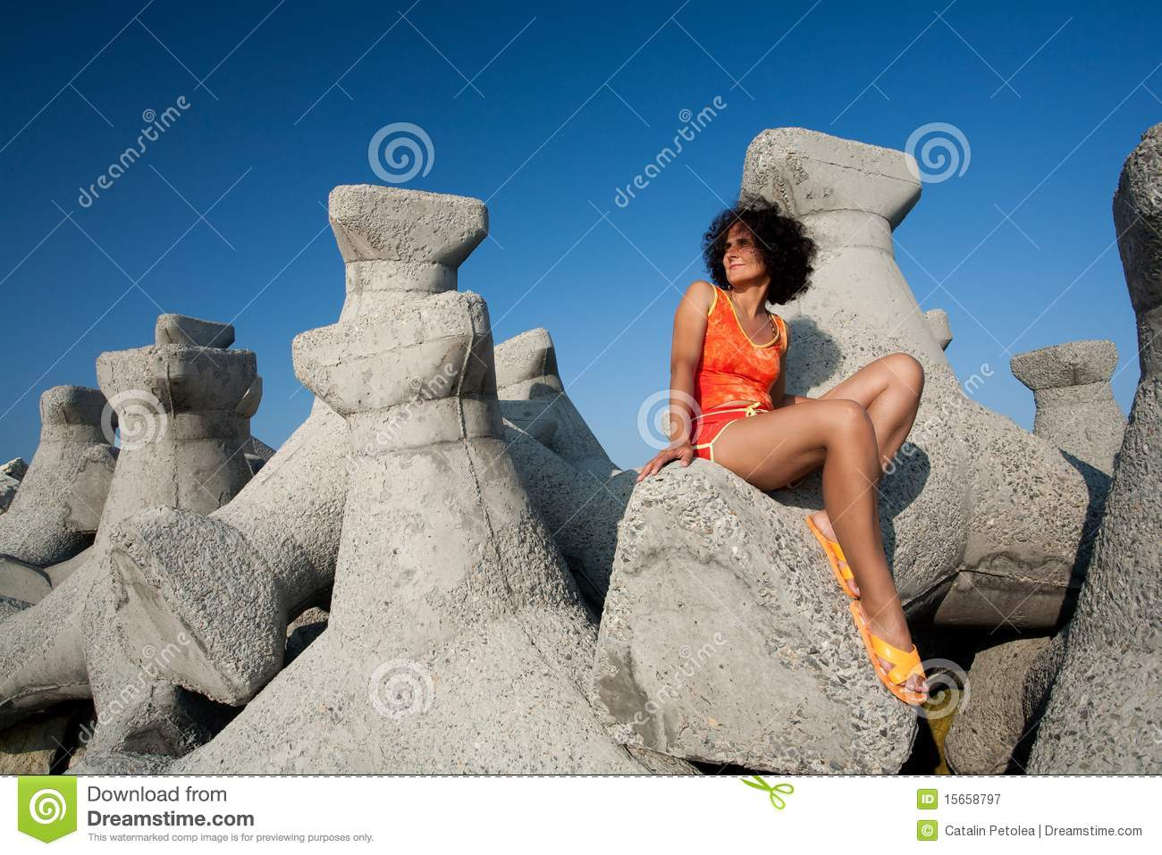 More Similar Stock Images Of Young Woman Sitting On Rocks