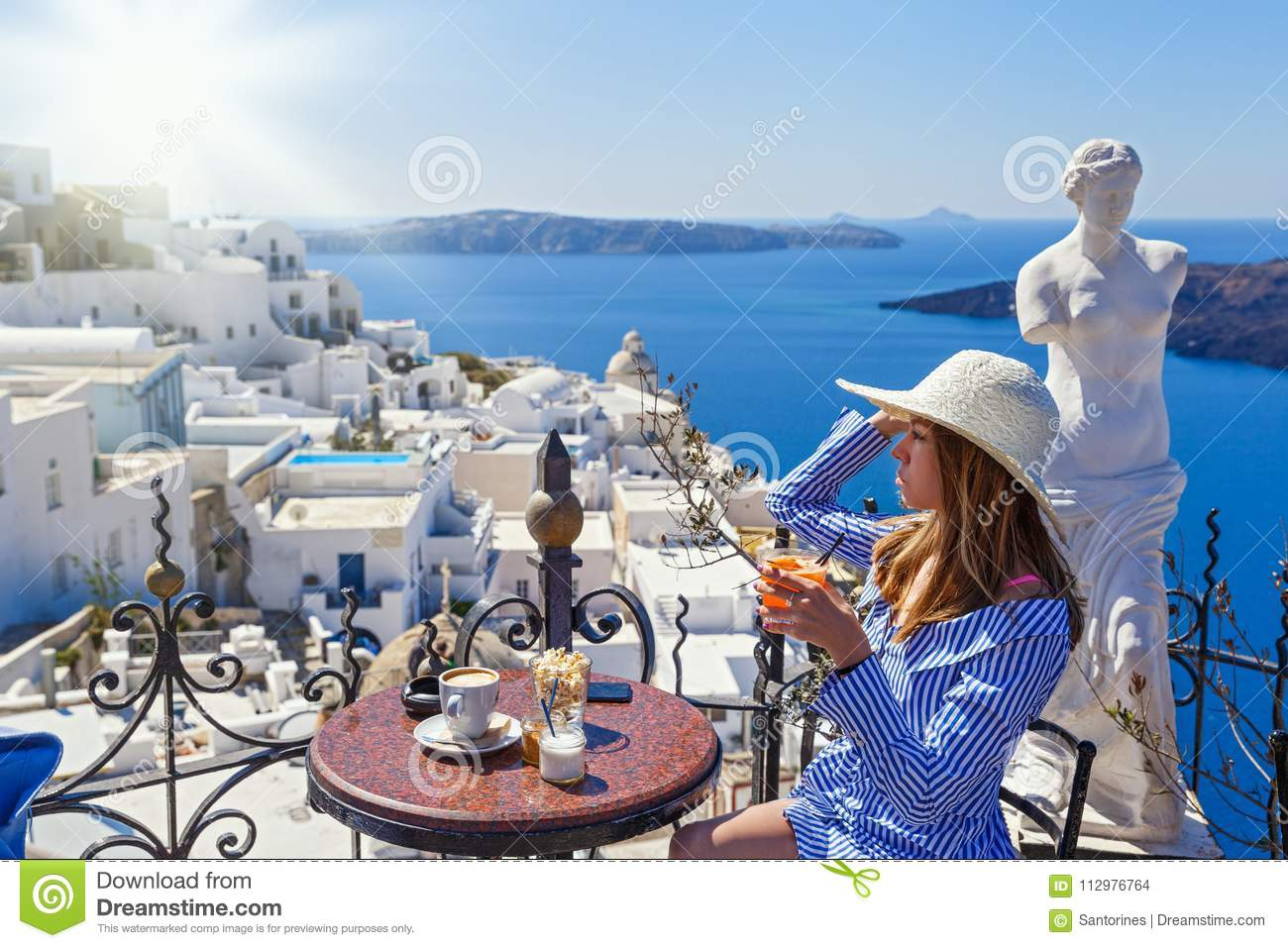 Young woman in a restaurant over the sea