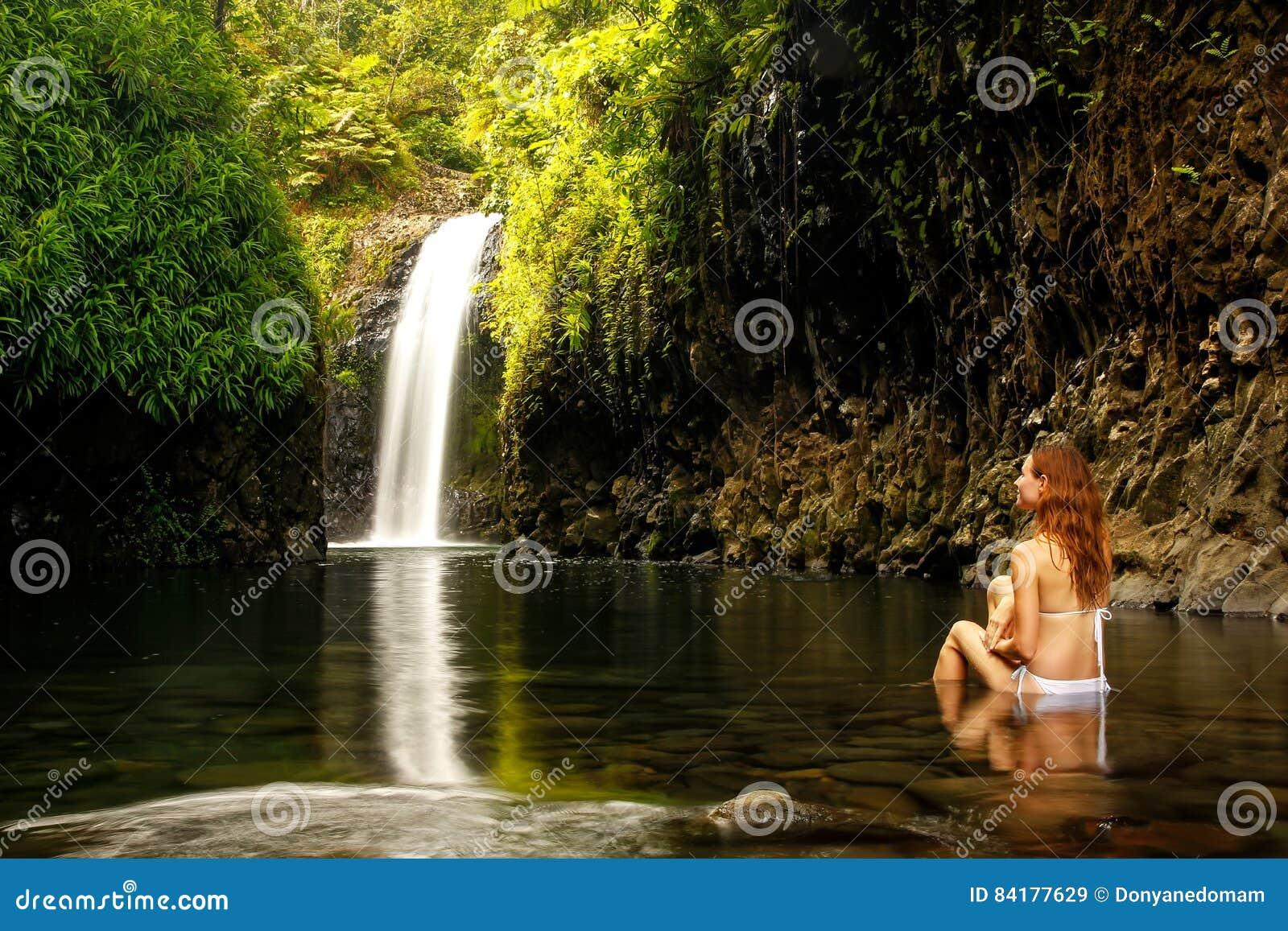 Woman Sitting At Erawan Waterfall In Thailand. Beautiful