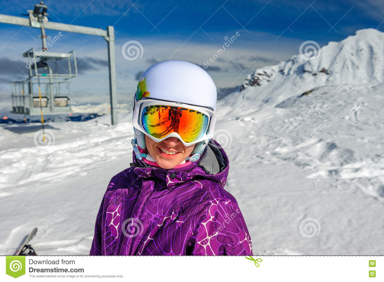 a1efd511385 Young woman in ski goggles outdoors with French Alps covered with snow at  background. Meribel
