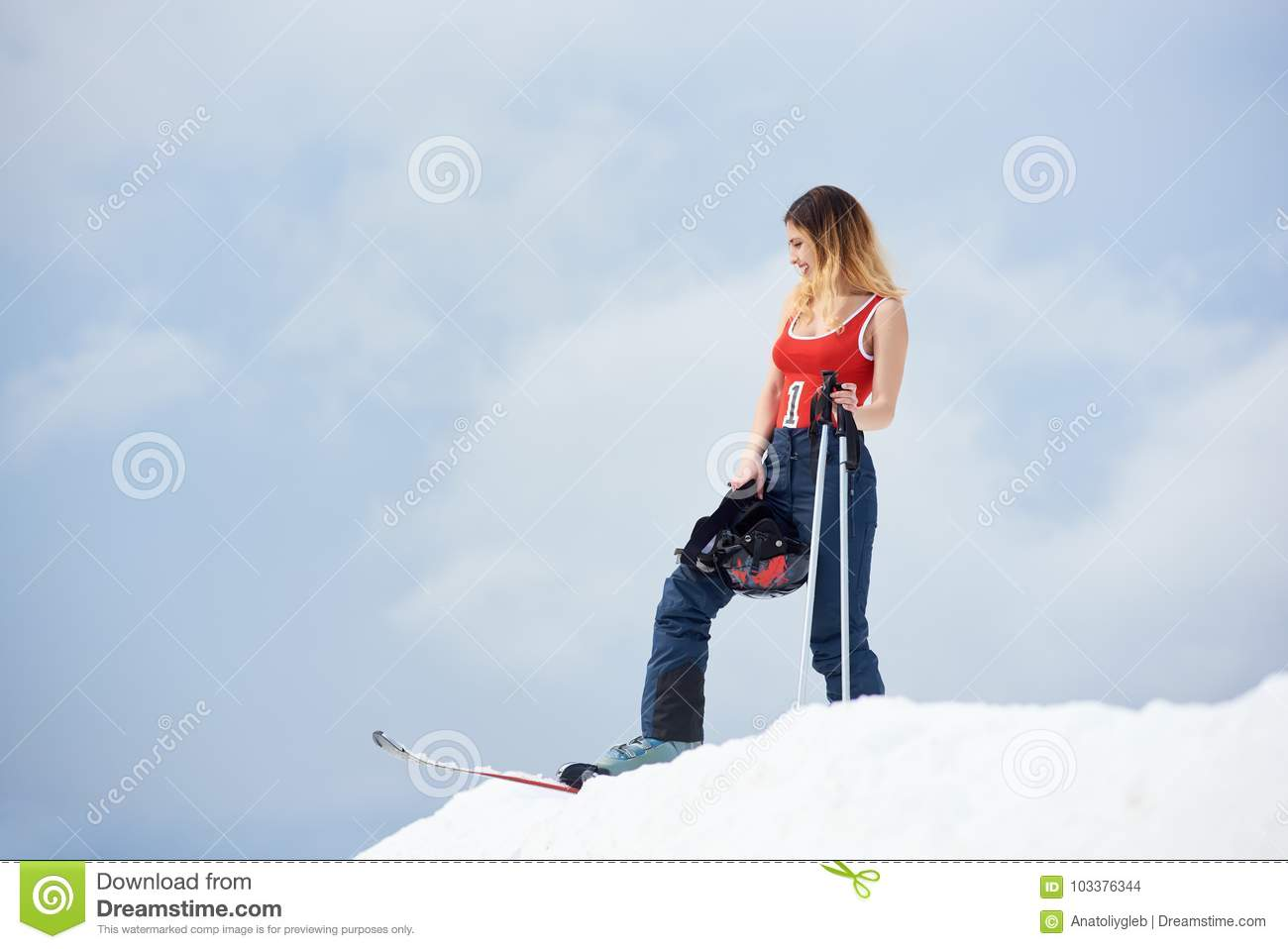 8a3dc0d15c4 Woman Skier On The Top Of The Snowy Hill With Skis At Ski Resort ...