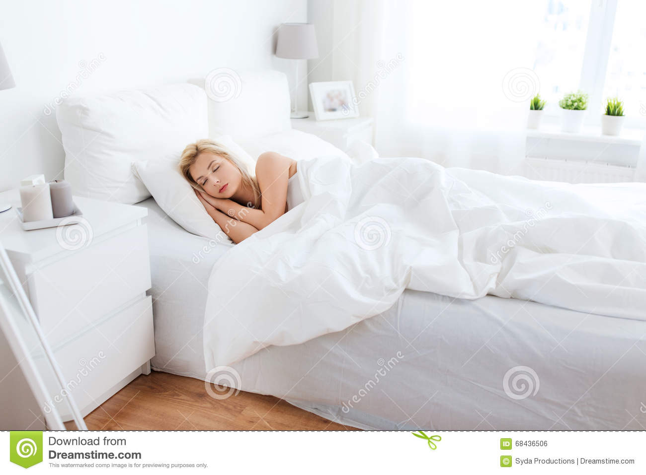 Young woman sleeping in bed at home bedroom stock photo for Comfort house