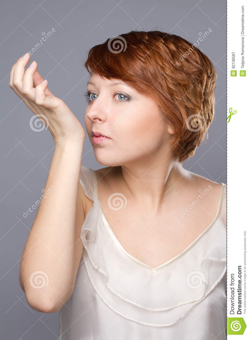 Young woman smells pafrume on her hand