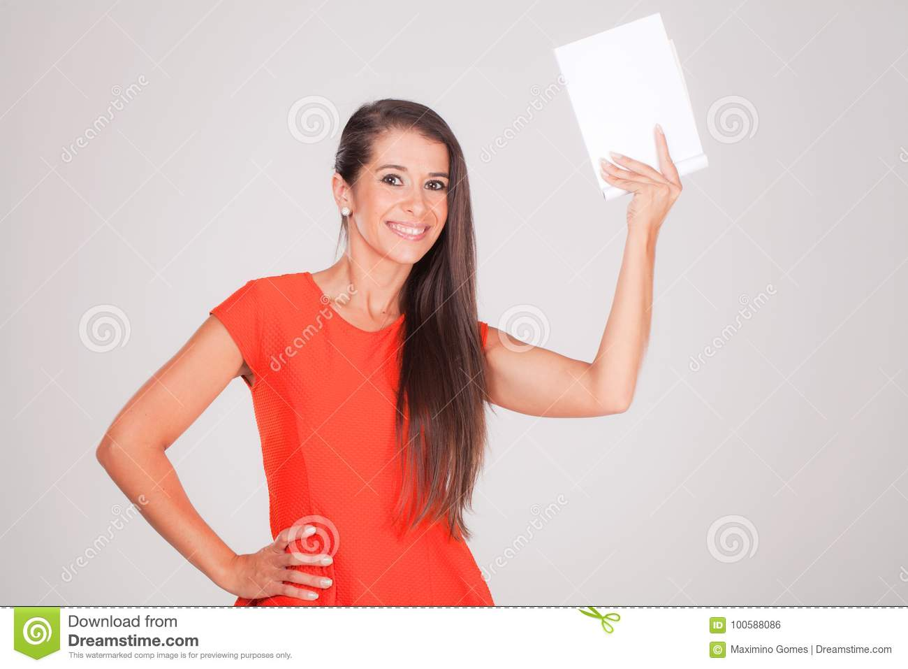 Young woman, smiles holding a notebook