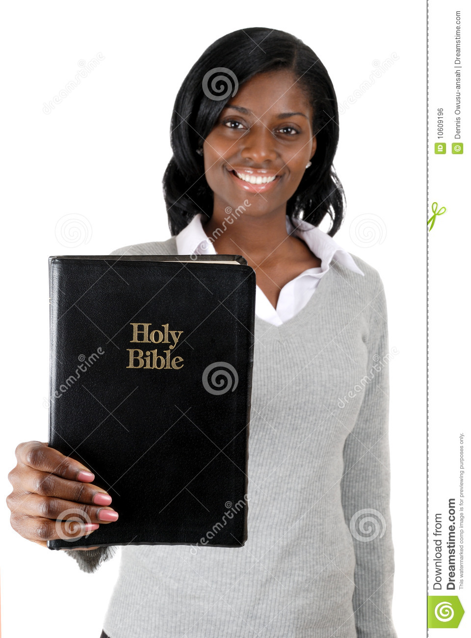 Young woman smiling with a bible