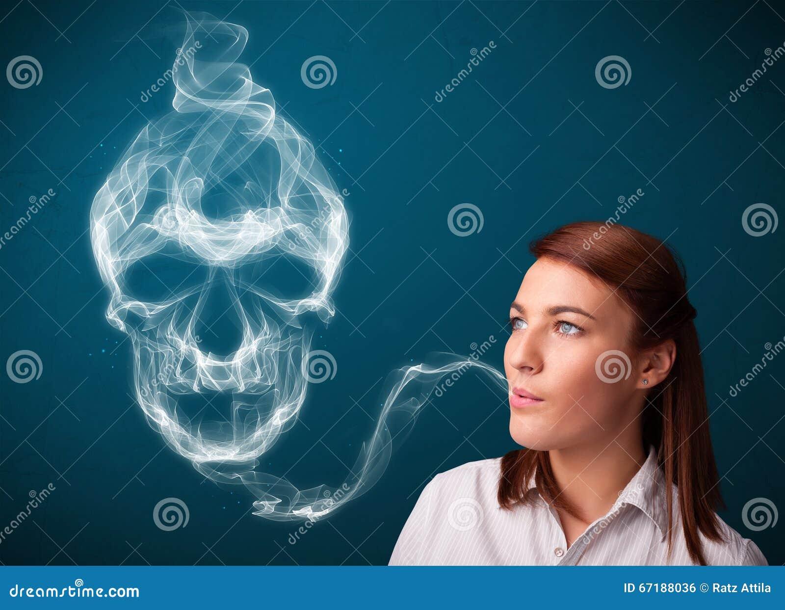 Young woman smoking dangerous cigarette with toxic skull smoke