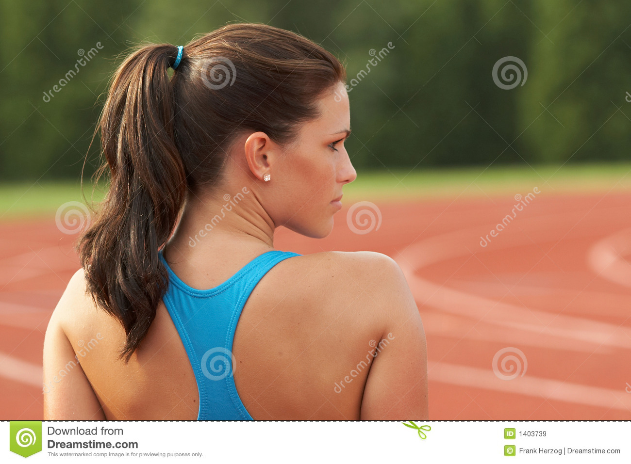 Young Woman In Sports Bra Looking Over Shoulder Stock ...