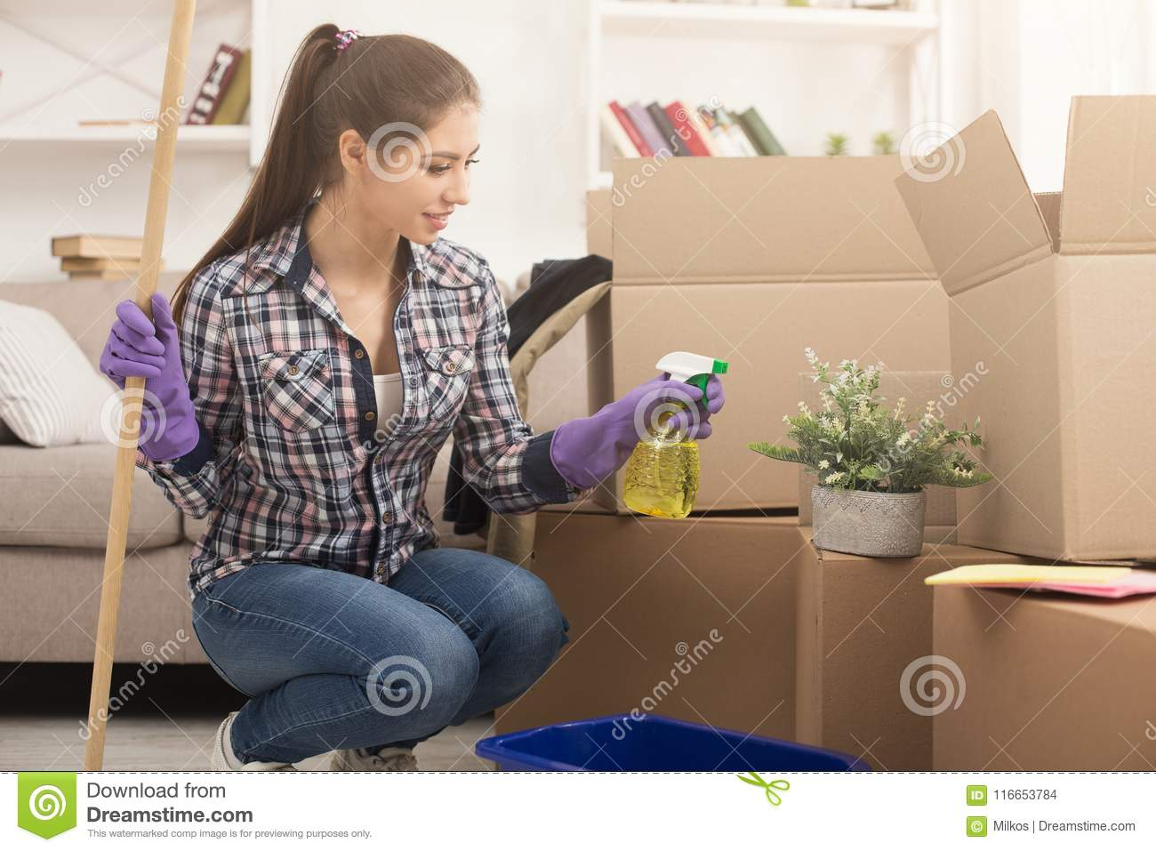 Young Woman Sprinkles Houseplant While Cleaning New Apartment New Home Spring Cleaning Copy Space