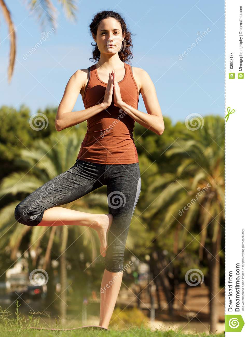 Young Woman Standing Open One Leg In Yoga Position Stock ...