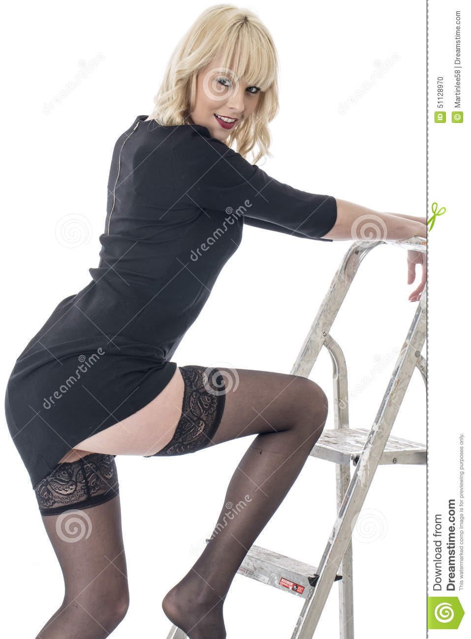 01d48bef321 Young Woman Stepping on Ladder with Thigh Showing Wearing Black Stockings