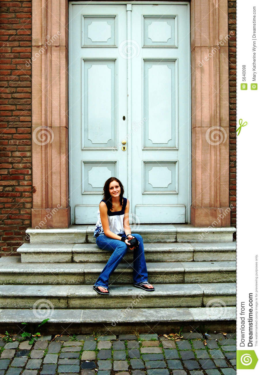 Young Woman On Steps In Front Of Door Stock Photo Image Of