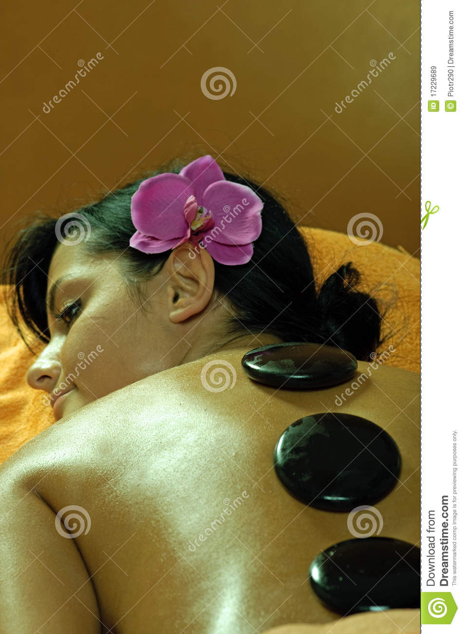 Young Woman and Stone Massage