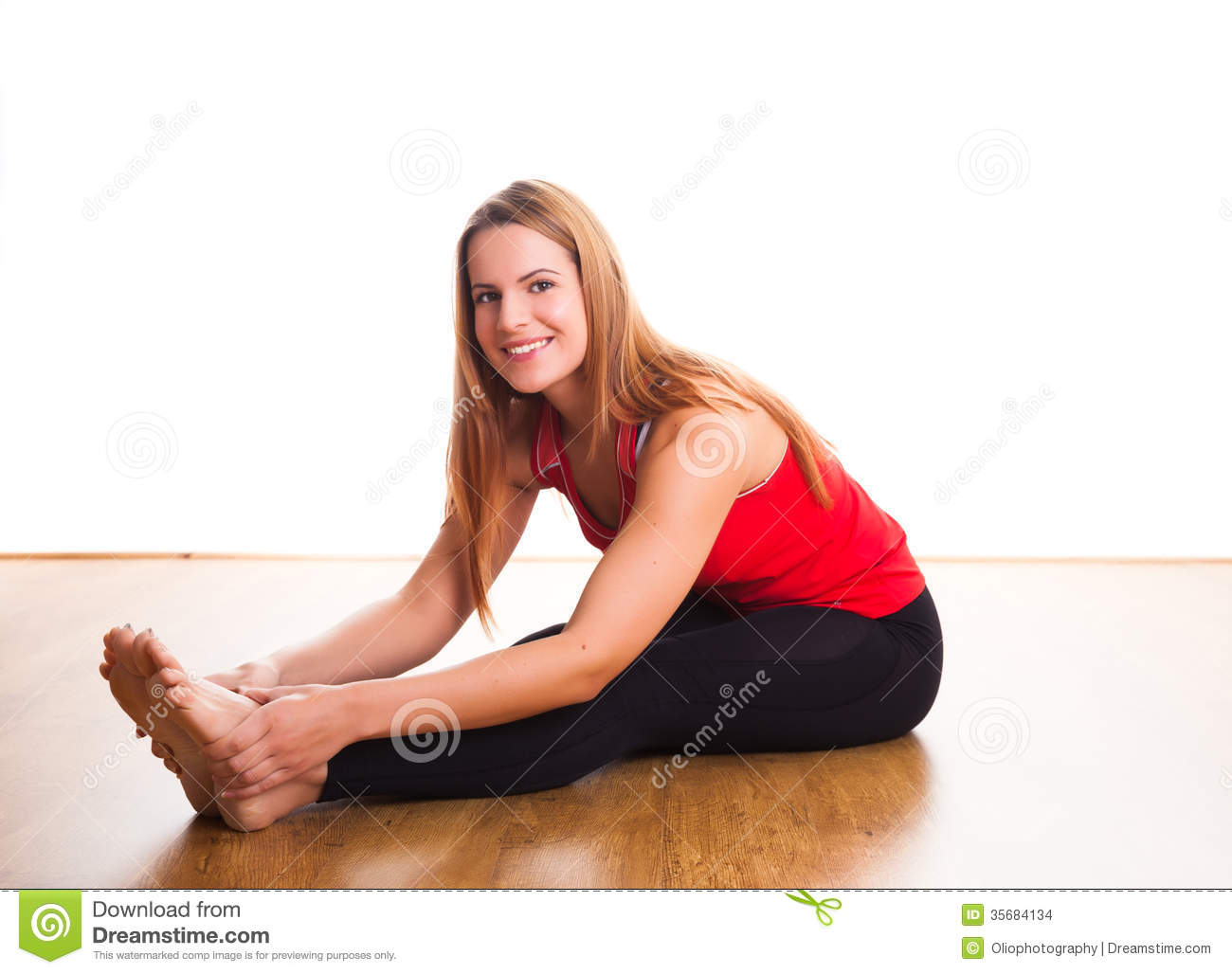 Young woman stretching stock photo image of flexible for Down to the floor