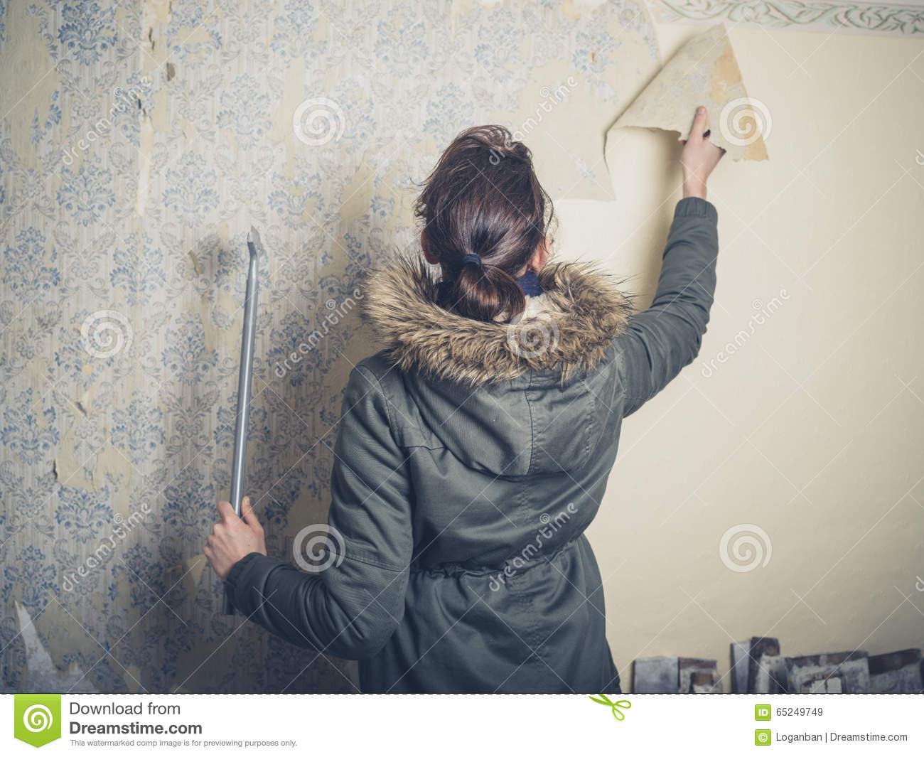 Download Young Woman Stripping Wallpaper Stock Image