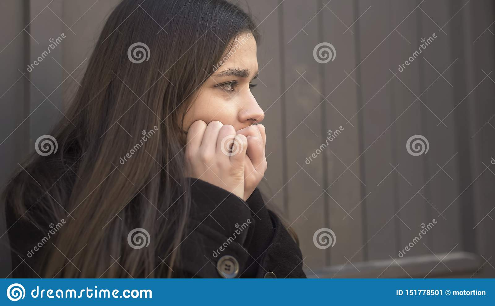 Young woman suddenly feeling panic attack in street, psychological problems