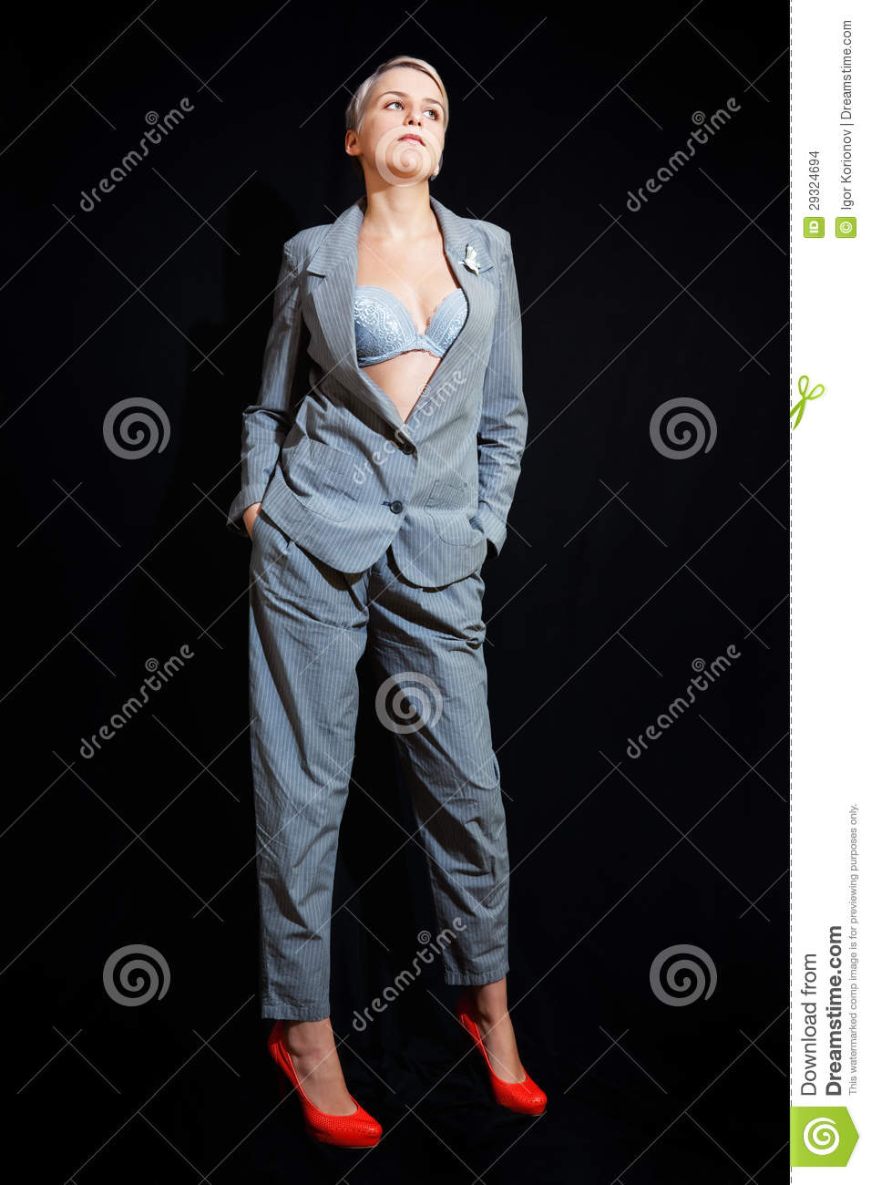 Young Woman In Suit And Bra On Black Background Stock
