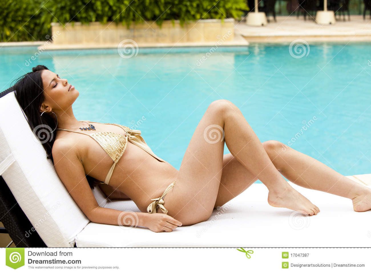Young Woman Sunbathing Poolside In A Bikini Royalty Free Stock graphy Image