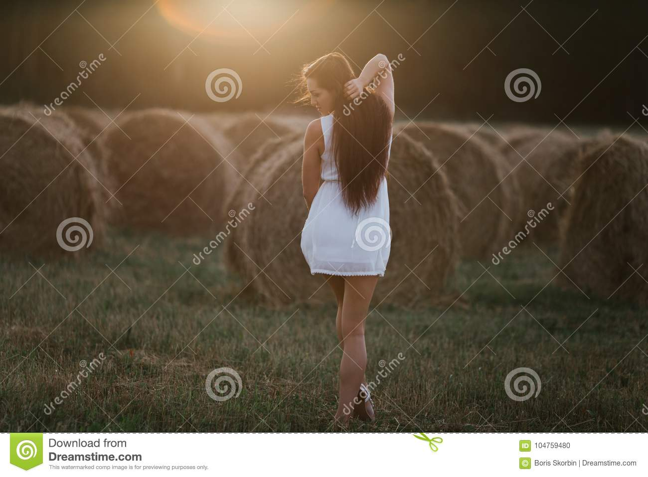 Young woman on sunrise field