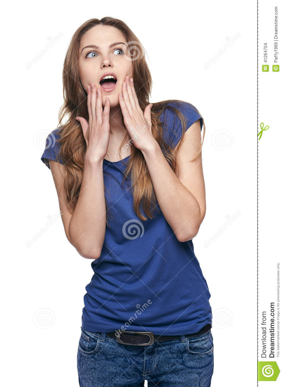 Portrait Of A Young Woman Looking Surprised High-Res Stock