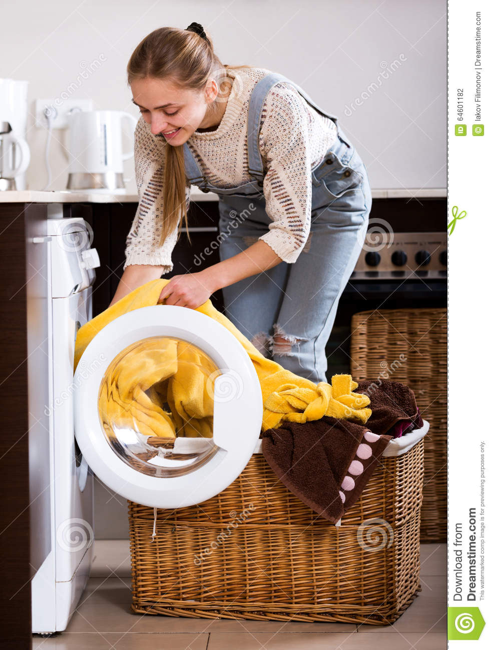 taking clothes out washing machine stock photo