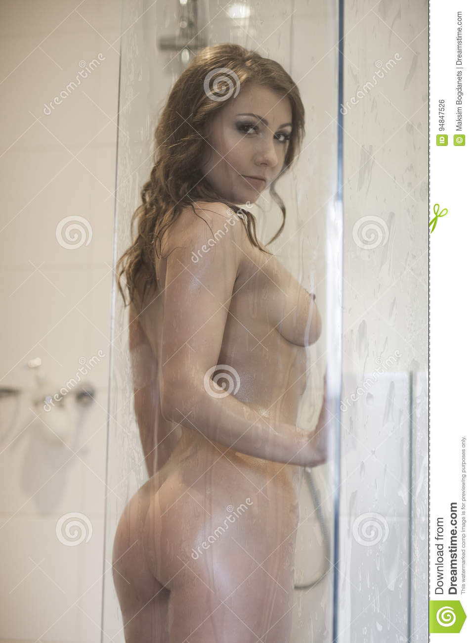 young woman taking shower, full naked looking at camera stock photo