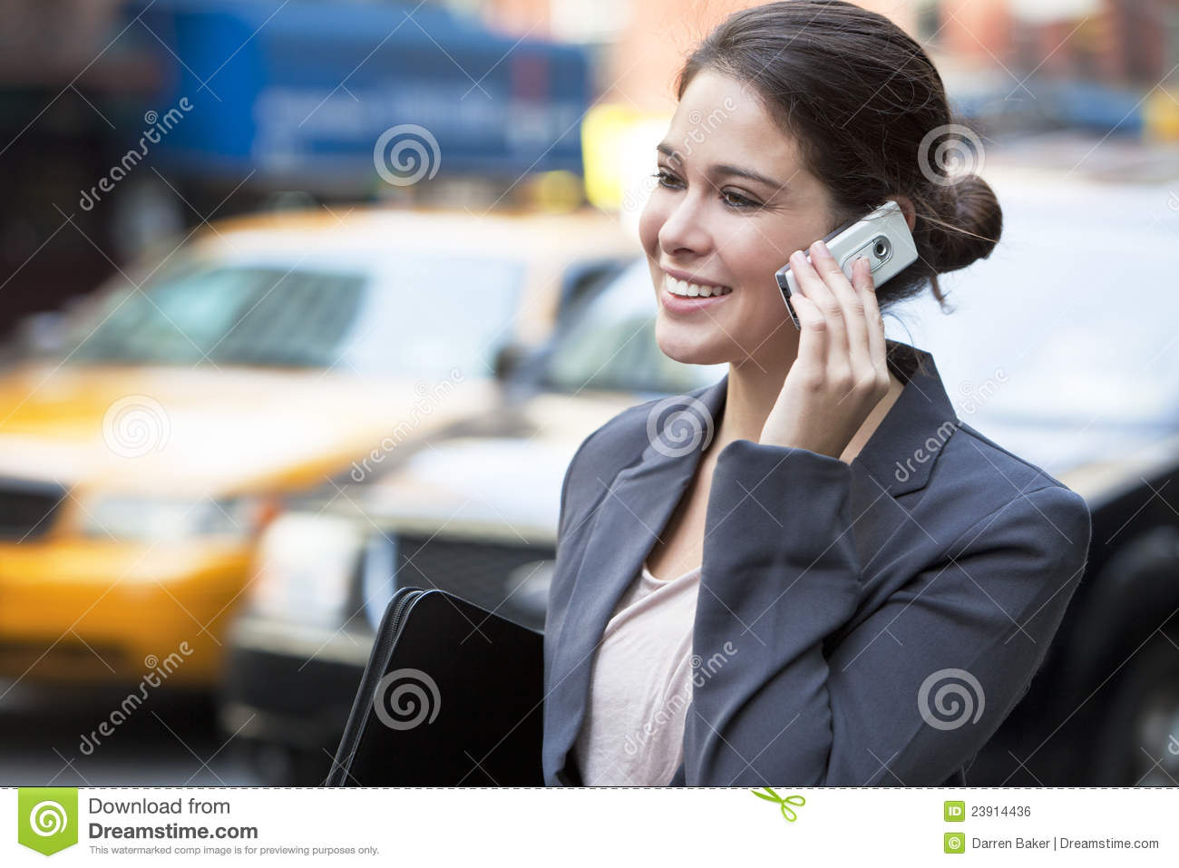 Young Woman Talking On Cell Phone By Yellow Taxi Stock ...