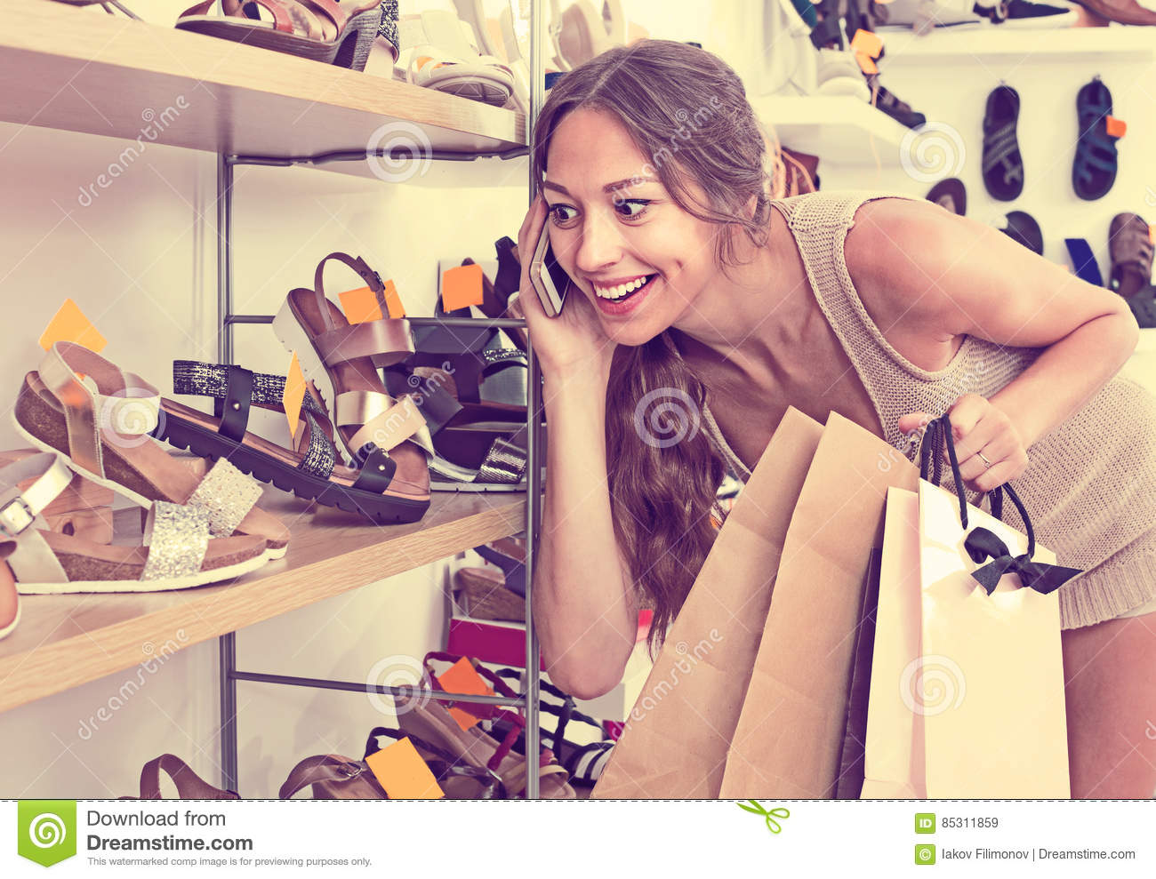 Young woman talking on mobile phone in boutique