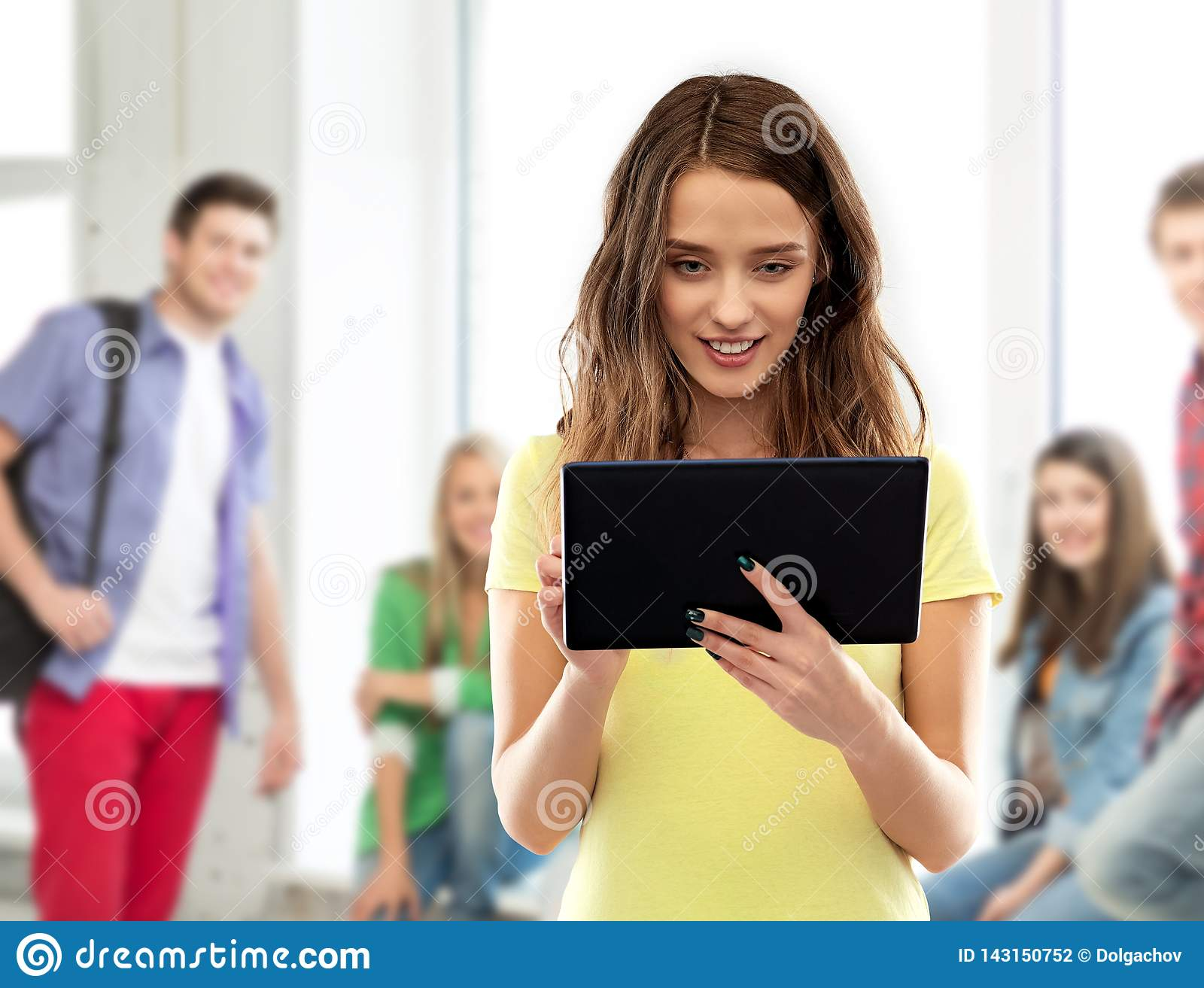 Young woman or teenage girl using tablet computer