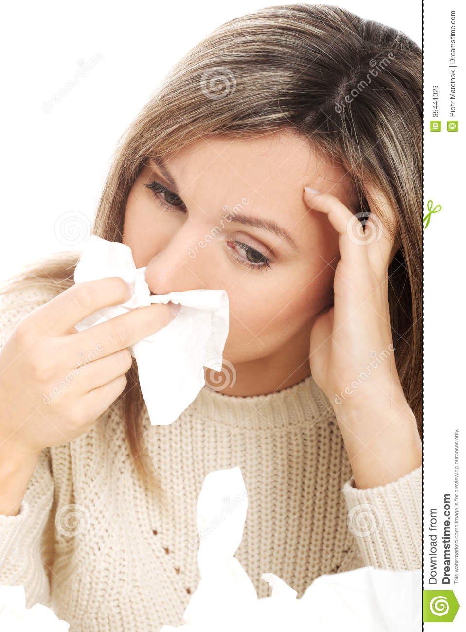 young woman with tissues crying having runny nose stock