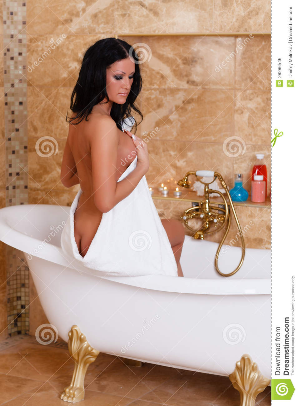 Young woman with towel in bathroom. Young Woman With Towel In Bathroom  Royalty Free Stock Image