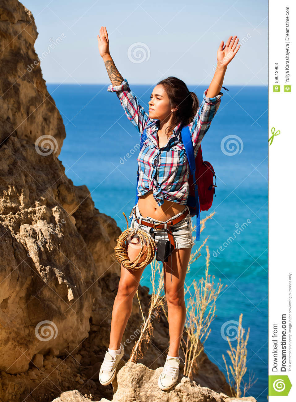 60013bbe9b0 Young woman traveler hiking girl with backpack hiking in mountains Grand  Canyon Crimea with beautiful summer sea landscape.