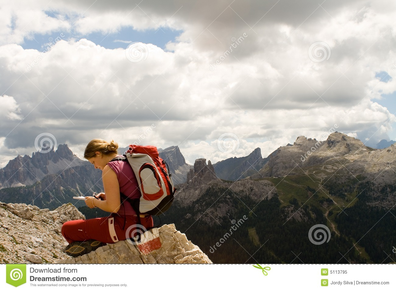 Young woman trekking Dolomite