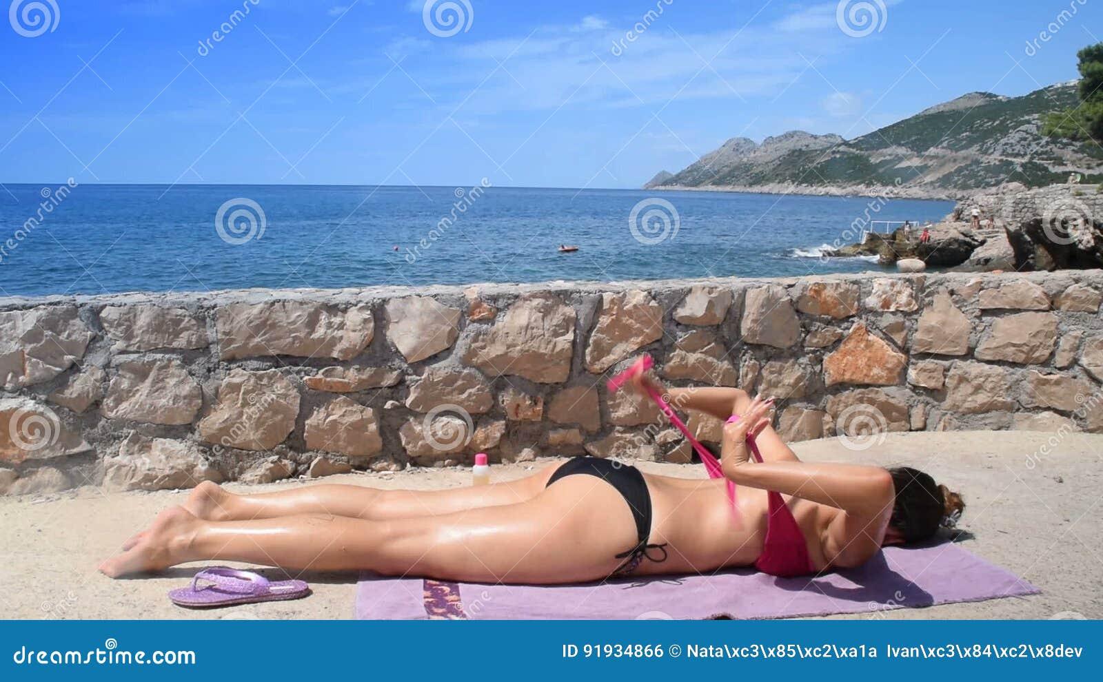 Young teen girls sunbathing