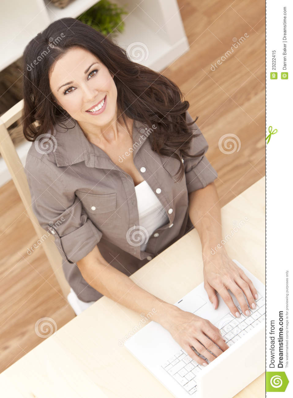 Young Woman Using Laptop Computer At Home