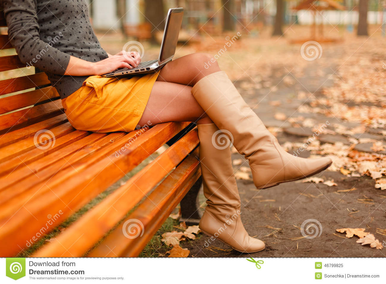 Young woman using laptop outdoor