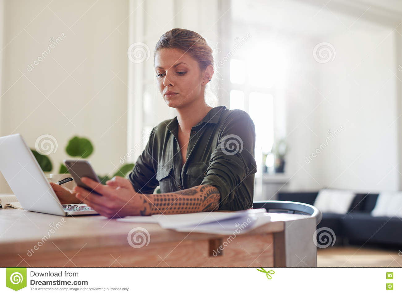 Stupendous Young Woman Using Mobile Phone At Home Office Stock Photo Image Largest Home Design Picture Inspirations Pitcheantrous