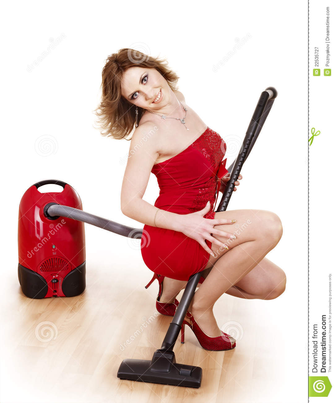 young woman using vacuum cleaner  royalty free stock