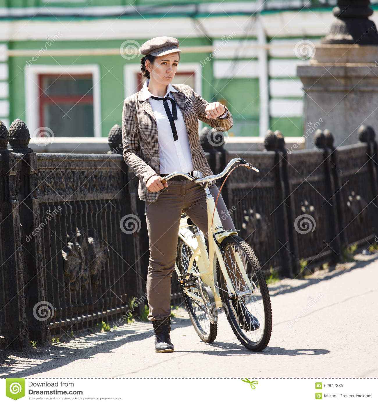 British Style Makers: Young Woman At Vintage Bicycle British Style Stock Image