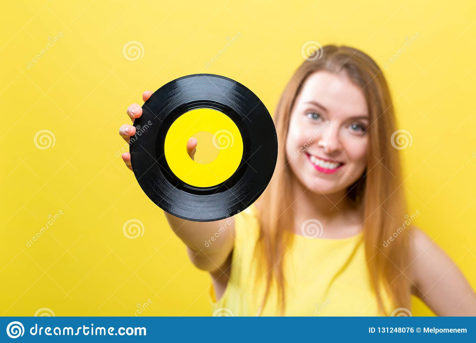 Young woman with a vinyl record
