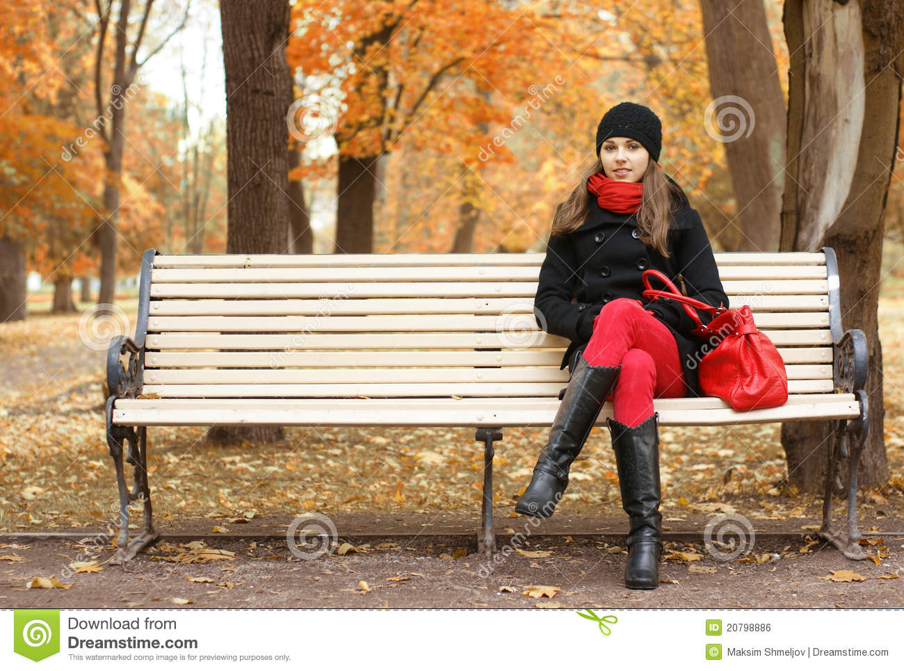 A Young Woman Waiting For Someone On A Bench Royalty Free ...
